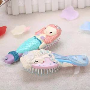 Factory direct selling products cartoon plastic comb with low price