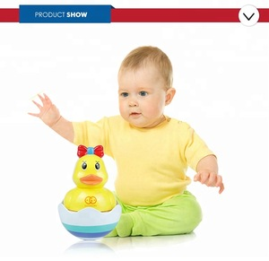 Plastic yellow duck bath baby tumbler roly poly toy for wholesale