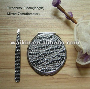 Manicure set including tweezers and mirror with crystal