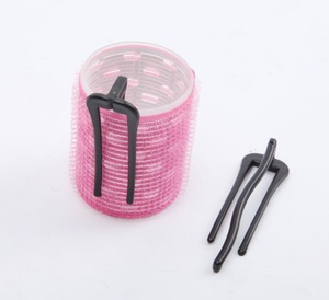 Self-adhesive hair roller with pins